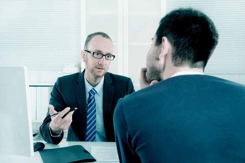 Arbeitnehmer und Arbeitgeber im Gespräch